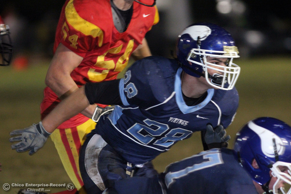 . Pleasant Valley High\'s #28 Nick Gudgel against Chico High in the first quarter of their Almond Bowl football game at CSUC University Stadium Friday, October 22, 2010 in Chico, Calif.
