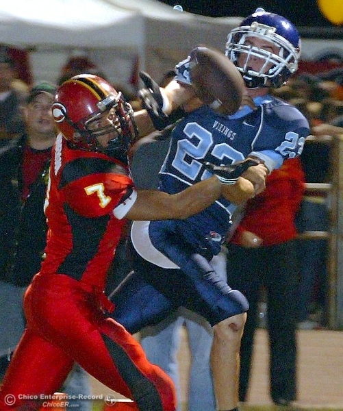 . Chico High\'s #7 Nate Anderson (left) is called for a penalty on interference against Pleasant Valley High\'s #23 Mycal Swaim (right) in the first quarter of their 2008 Almond Bowl Football game Friday, October 17, 2008 at CSUC University Stadium in Chico, CA. 