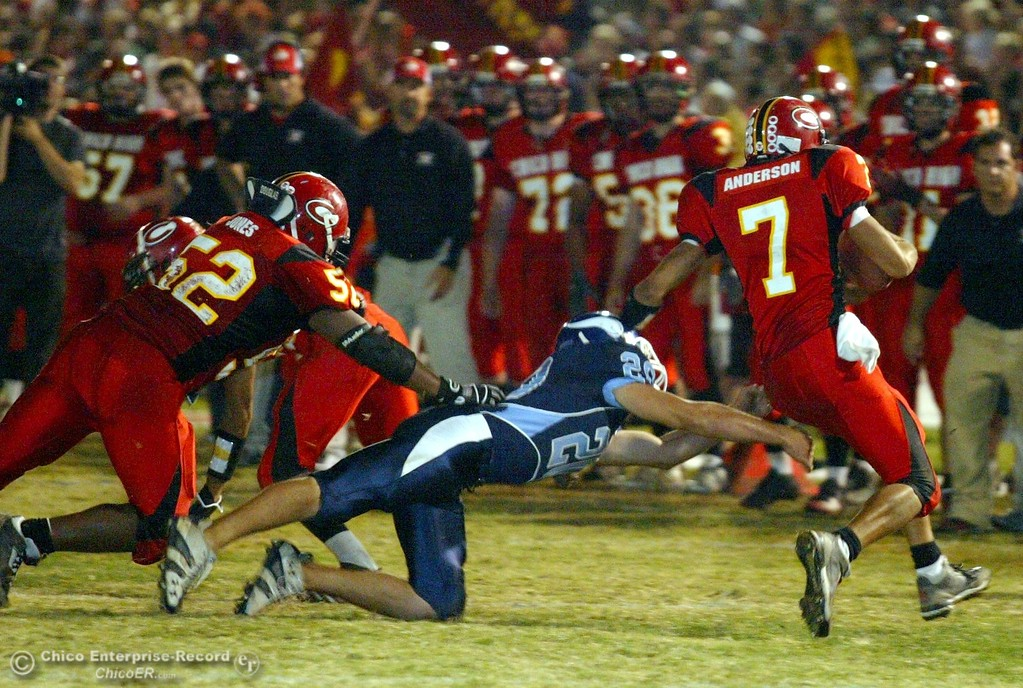 . Chico High\'s #7 Nate Anderson (right) is tackled against Pleasant Valley High\'s #20 Tyler McMahan (center) in the first quarter of their 2008 Almond Bowl Football game Friday, October 17, 2008 at CSUC University Stadium in Chico, CA. 