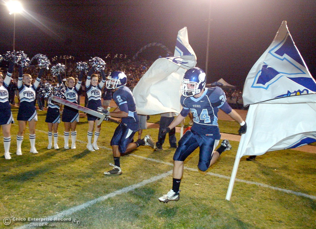 . Pleasant Valley High\'s #2 Logan Valencia (left) and #34 Joey Ruth (right) come onto the field against Chico High before the first quarter of their Almond Bowl football game at CSUC University Stadium Friday, October 16, 2009 in Chico, Calif. (Jason Halley/Chico Enterprise-Record)