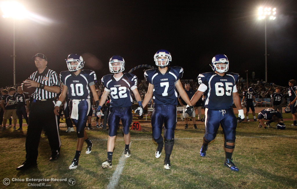 . Pleasant Valley High\'s #10 Eric Ascencio, #22 Michael Gerlach, #7 Kyle Forbis, and #65 Carlos Jauregui )(left to right) have the coin toss against Chico High  in the first quarter during their Almond Bowl XLI football game at CSUC University Stadium Friday, October 21, 2011 in Chico, Calif. (Jason Halley/Chico Enterprise-Record)