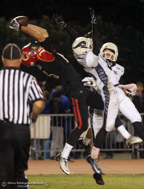 . Chico High\'s #15 Burak Karatekeli (left) catches for a touchdown against Pleasant Valley High\'s #85 Trey Rosenbalm (center) and #3 Brandon Romero (right) in the second quarter of their Almond Bowl football game at CSUC University Stadium Friday, October 26, 2012 in Chico, Calif. (Jason Halley /Chico Enterprise-Record)