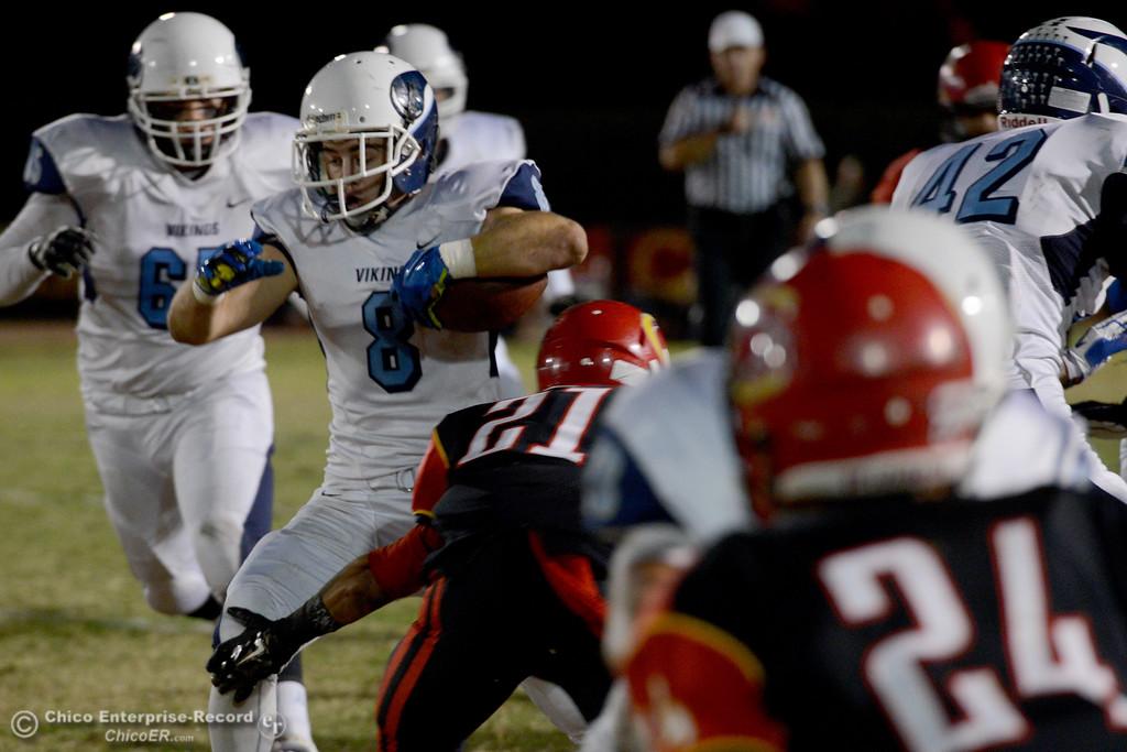 . Pleasant Valley running back Ethan Nash cuts to avoid Chico\'s Cameron Alfaro (21) during the Almond Bowl at University Stadium in Chico, California. (Dan Reidel -- Enterprise-Record)