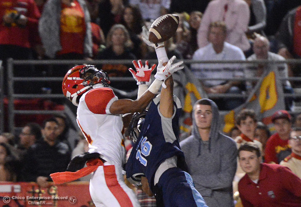 . Pleasant Valley\'s Jonathan Espinoza (16) manages to knock away a pass intented for Chico\'s Cliff Jackson (11) on Friday, Oct. 23, 2015, during the 45th Almond Bowl between Chico and Pleasant Valley high schools at University Stadium in Chico, California. (Dan Reidel -- Enterprise-Record)