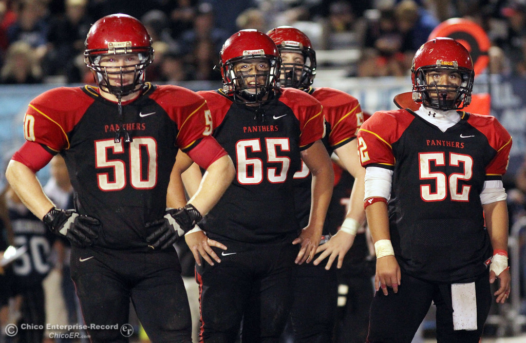 . Chico High\'s #50 Sam Miller, #65 Anthony Rodriguez, and #52 Caleb Akers (left to right) against Pleasant Valley High in the fourth quarter of their Almond Bowl football game at CSUC University Stadium Friday, October 26, 2012 in Chico, Calif. (Jason Halley /Chico Enterprise-Record)