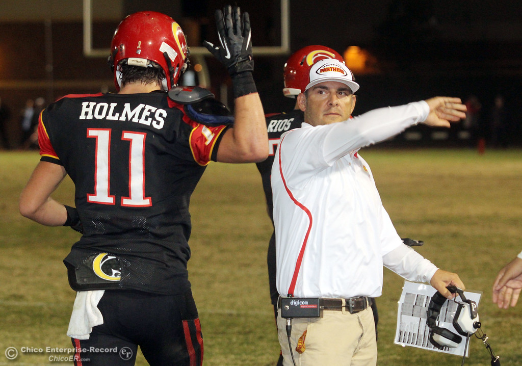 . Chico High\'s #11 Jesse Holmes (left) is congratulated by coach Jason Alvistur (right) on scoring a touchdown against Pleasant Valley High in the second quarter of their Almond Bowl football game at CSUC University Stadium Friday, October 26, 2012 in Chico, Calif. (Jason Halley /Chico Enterprise-Record)