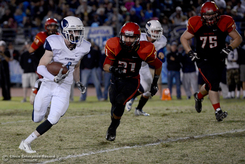 . Pleasant Valley running back Cyland Leitner (4) runs as Chico\'s Cameron Alfaro (21) takes an angle to make the tackle during the Almond Bowl at University Stadium in Chico, California. (Dan Reidel -- Enterprise-Record)