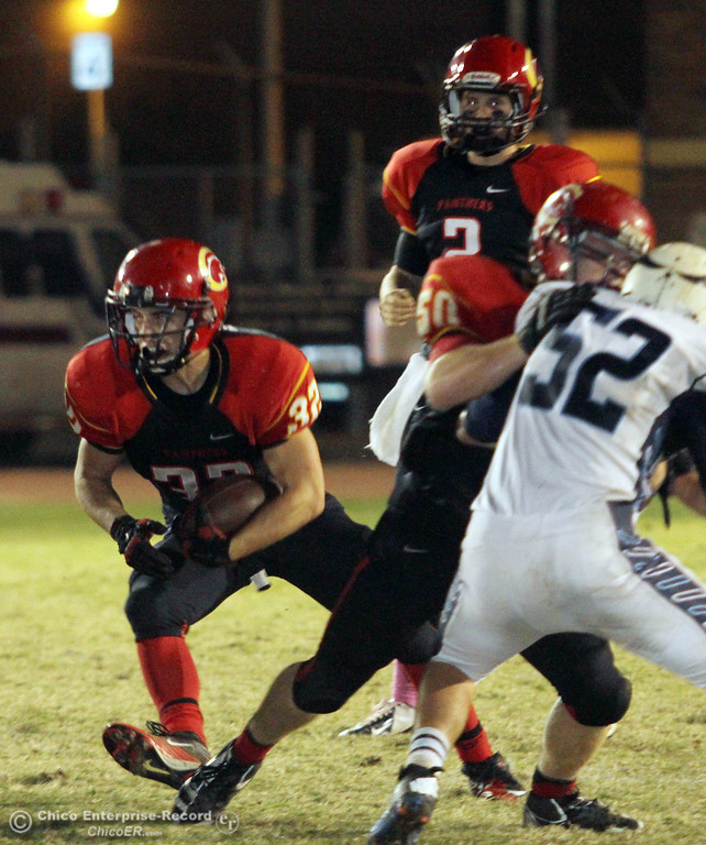 . Chico High\'s #32 KJ Young (left) rushes against Pleasant Valley High in the second quarter of their Almond Bowl football game at CSUC University Stadium Friday, October 26, 2012 in Chico, Calif. (Jason Halley /Chico Enterprise-Record)