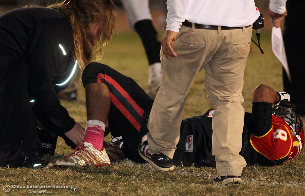 . Chico High\'s #8 Jesse Chambers suffered a twisted ankle injury against Pleasant Valley High in the fourth quarter of their Almond Bowl football game at CSUC University Stadium Friday, October 26, 2012 in Chico, Calif. (Jason Halley /Chico Enterprise-Record)