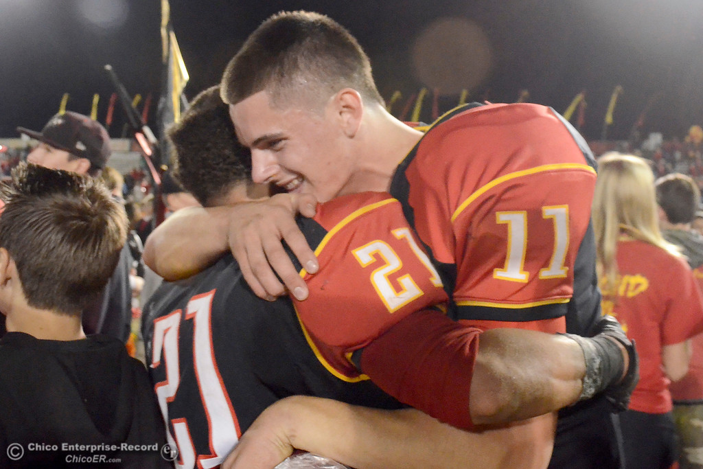. Chico\'s Clayton Welch (11) and Cameron Alfaro hugs after an overtime victory in the Almond Bowl at University Stadium in Chico, California. (Dan Reidel -- Enterprise-Record)