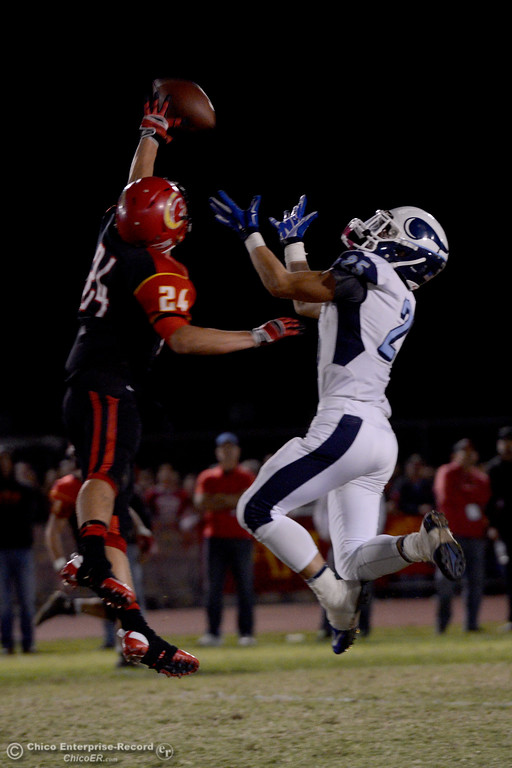 . Creed Smith (24) defens a pass to Jordan Cooley (25) Friday, Oct. 24, 2014, during the Almond Bowl at University Stadium in Chico, California. (Dan Reidel -- Enterprise-Record)