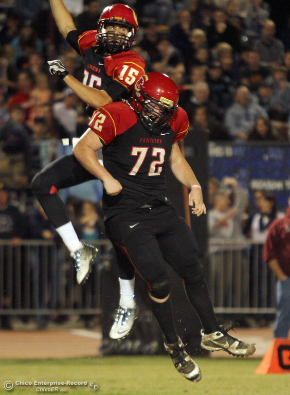. Chico High\'s #15 Burak Karatekeli (top) celebrates scoring a touchdown with #72 Atty Pierce (bottom) against Pleasant Valley High in the second quarter of their Almond Bowl football game at CSUC University Stadium Friday, October 26, 2012 in Chico, Calif. (Jason Halley /Chico Enterprise-Record)