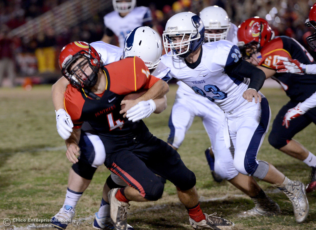 . Chico\'s Grant Adams (4) gets hit hard by the Pleasant Valley defense during the Almond Bowl at University Stadium in Chico, California. (Dan Reidel -- Enterprise-Record)