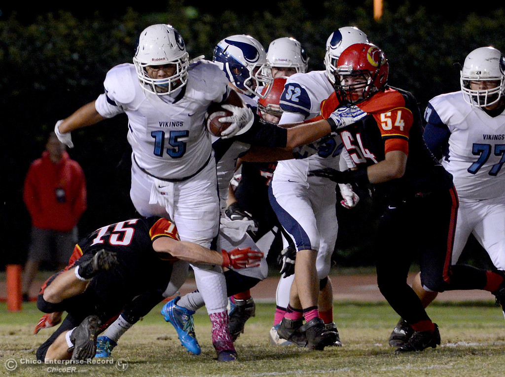 . Chico\'s Miles Fishback (15) manages to trip Pleasant Valley running back Anthony Jensen (15) during the Almond Bowl at University Stadium in Chico, California. (Dan Reidel -- Enterprise-Record)