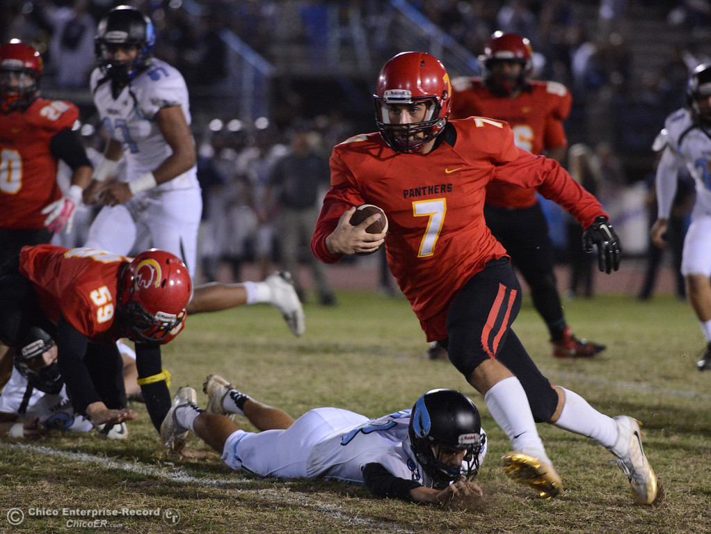 . Cole Walker (7) rushes for an 18-yard gain in the Almond Bowl against Pleasant Valley on Friday, Oct. 21, 2016, at University Stadium in Chico, California.