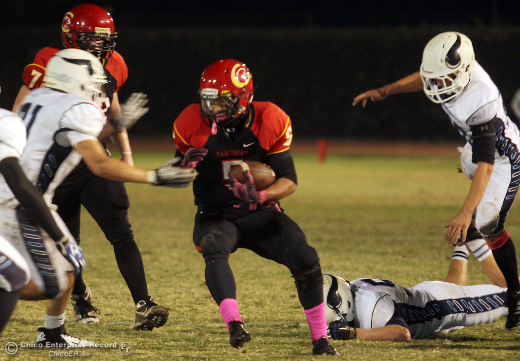. Chico High\'s #5 Trevon Reid rushes against Pleasant Valley High in the second quarter of their Almond Bowl football game at CSUC University Stadium Friday, October 26, 2012 in Chico, Calif. (Jason Halley /Chico Enterprise-Record)
