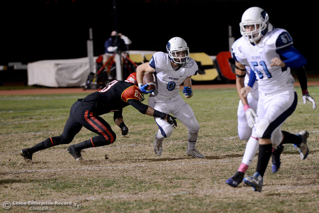 . Pleasant Valley running back Ethan Nash (8) breaks a tackle by Deandre Horn (23) during the Almond Bowl at University Stadium in Chico, California. (Dan Reidel -- Enterprise-Record)