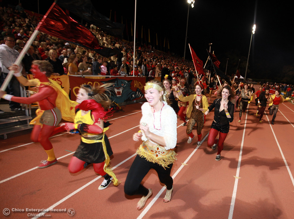 . Chico High fans run down the track against Pleasant Valley High in the first quarter of their Almond Bowl football game at CSUC University Stadium Friday, October 26, 2012 in Chico, Calif. (Jason Halley /Chico Enterprise-Record)