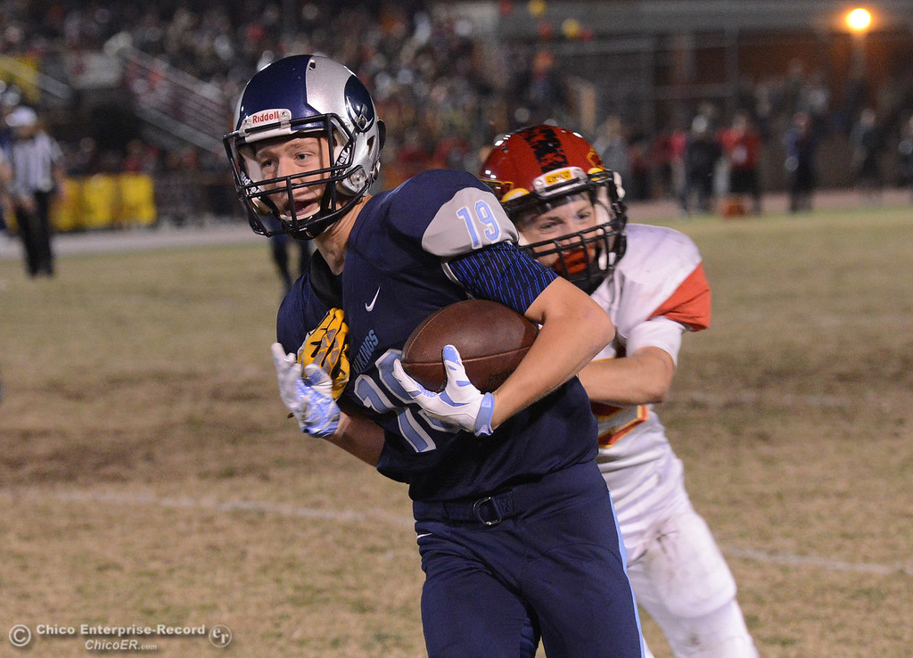 . Pleasant Valley\'s Max Andersen (19) catches a pass for a first down as Chico\'s Blayn Gieg (15) tackles him Friday, Oct. 23, 2015, during the 45th Almond Bowl between Chico and Pleasant Valley high schools at University Stadium in Chico, California. (Dan Reidel -- Enterprise-Record)
