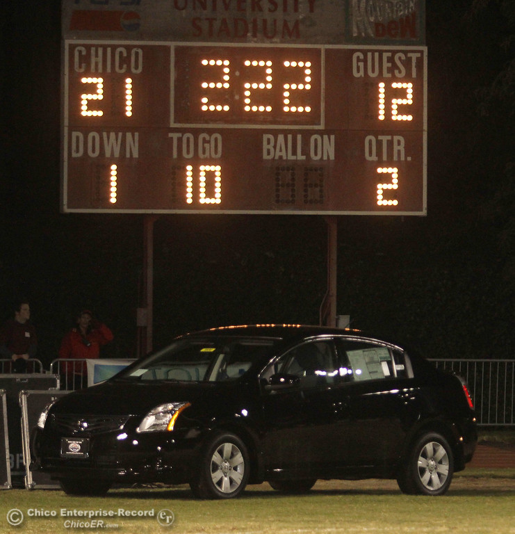 . The car was a giveaway during halftime at the Chico High against Pleasant Valley High in the second quarter of their Almond Bowl football game at CSUC University Stadium Friday, October 26, 2012 in Chico, Calif. (Jason Halley /Chico Enterprise-Record)