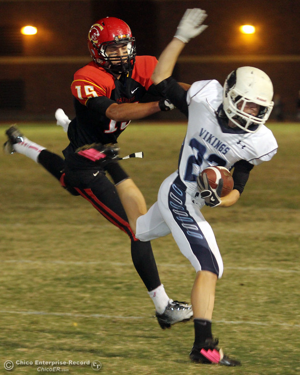 . Chico High\'s #15 Burak Karatekeli (left) pushes Pleasant Valley High\'s  #22 Jake Dani (right) out of bounds in the first quarter of their Almond Bowl football game at CSUC University Stadium Friday, October 26, 2012 in Chico, Calif. (Jason Halley /Chico Enterprise-Record)