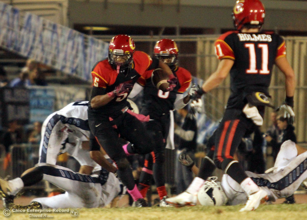 . Chico High\'s #5 Trevon Reid (center) rushes against Pleasant Valley High in the second quarter of their Almond Bowl football game at CSUC University Stadium Friday, October 26, 2012 in Chico, Calif. (Jason Halley /Chico Enterprise-Record)