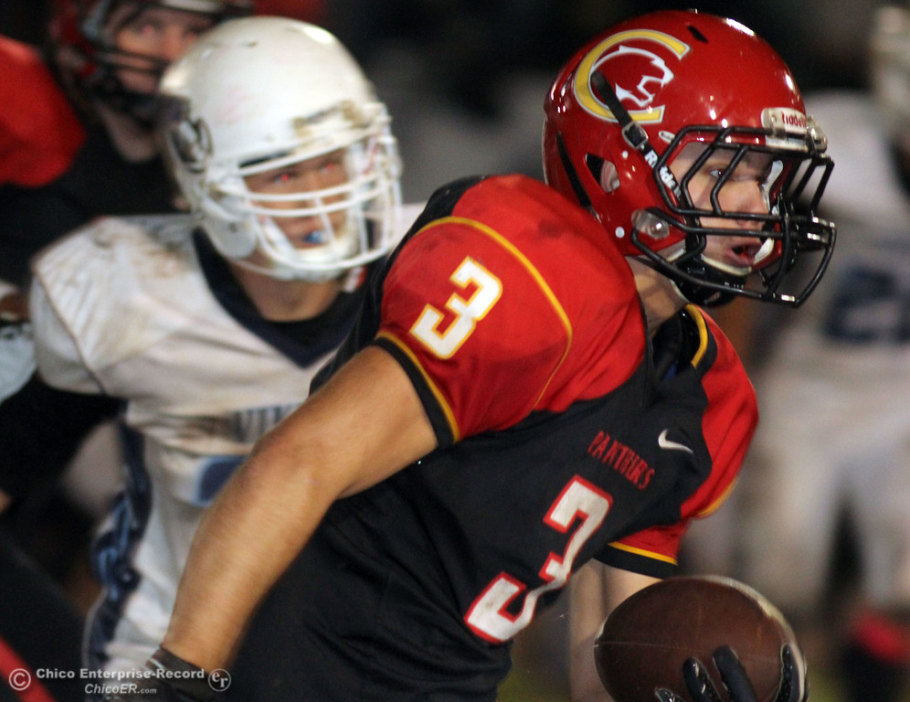. Chico High\'s #3 Cordero Rios rushes against Pleasant Valley High in the fourth quarter of their Almond Bowl football game at CSUC University Stadium Friday, October 26, 2012 in Chico, Calif. (Jason Halley /Chico Enterprise-Record)