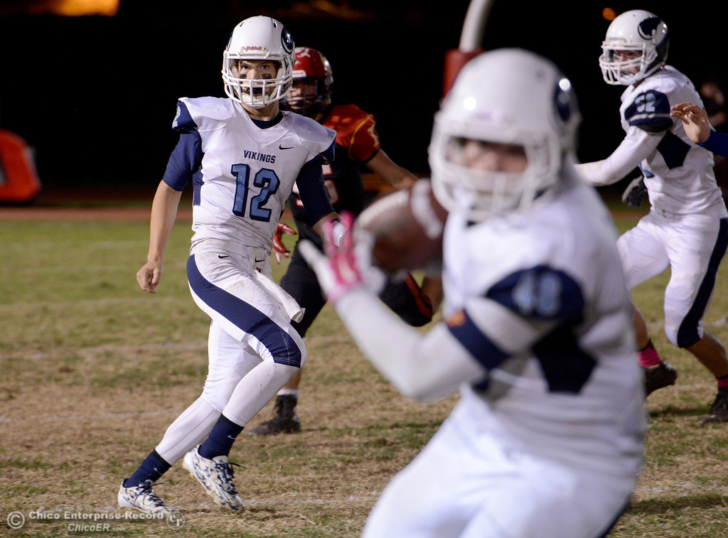 . Trent Darms (12) completes a pass to Devin Berger (48) during the Almond Bowl at University Stadium in Chico, California. (Dan Reidel -- Enterprise-Record)