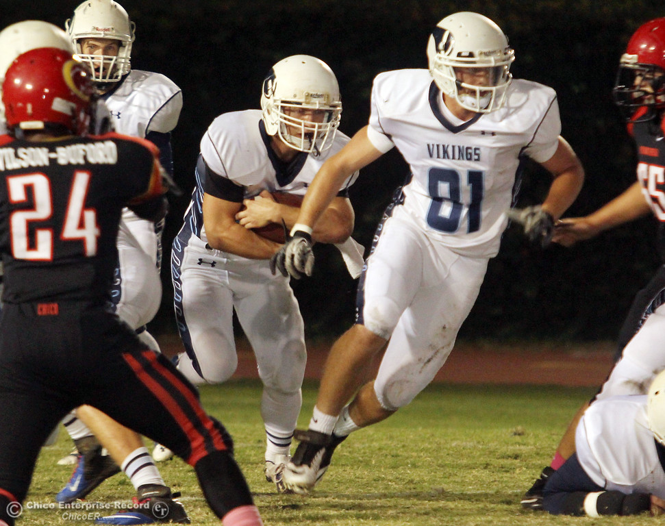 . Chico High against Pleasant Valley High\'s #40 Sam Savercool (center) rushes behind #81 Chase Ceccatto (rihgt) in the first quarter of their Almond Bowl football game at CSUC University Stadium Friday, October 26, 2012 in Chico, Calif. (Jason Halley /Chico Enterprise-Record)
