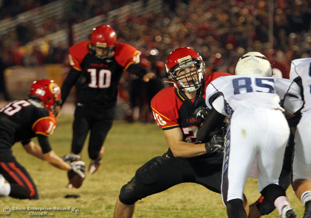. Chico High\'s #20 Paulo Disano (center) blocks against Pleasant Valley High\'s #85 Trey Rosenbalm (right) in the second quarter of their Almond Bowl football game at CSUC University Stadium Friday, October 26, 2012 in Chico, Calif. (Jason Halley /Chico Enterprise-Record)