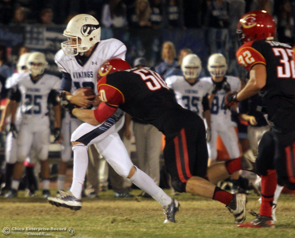. Chico Highs\' #50 Sam Miller (right) tackles against Pleasant Valley High\'s #12 Gregory Darms (left) in the first quarter of their Almond Bowl football game at CSUC University Stadium Friday, October 26, 2012 in Chico, Calif. (Jason Halley /Chico Enterprise-Record)