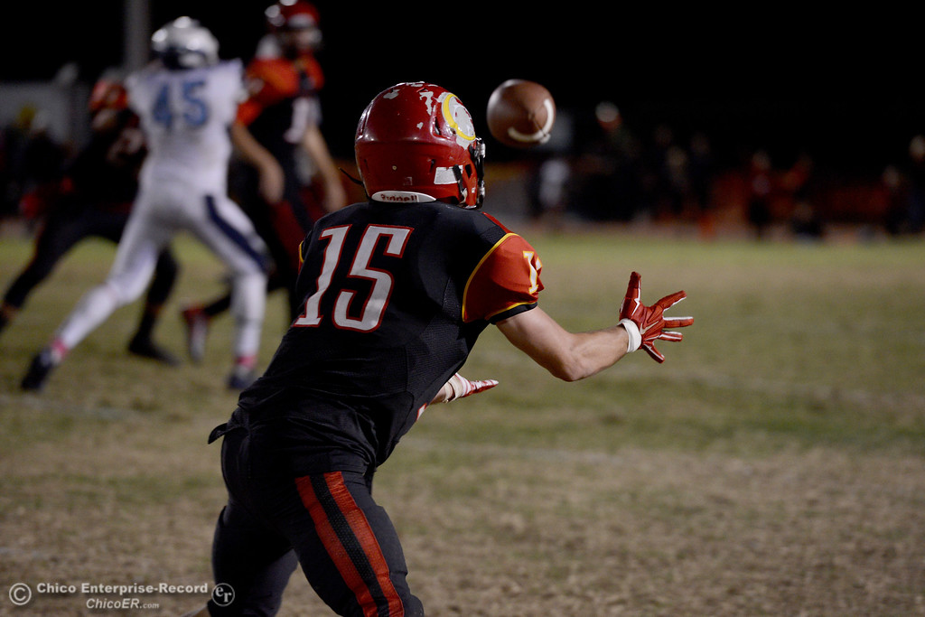 . Miles Fishback (15) catches a pass Friday, Oct. 24, 2014, during the Almond Bowl at University Stadium in Chico, California. (Dan Reidel -- Enterprise-Record)