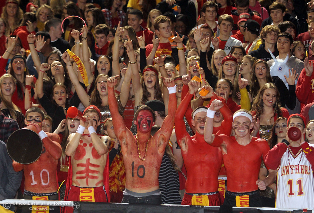 . Chico High fans Tony Bondurant, Tanner Binsfield, Ben Nokleby, Clayton Schuler, Morey Marshall, and Jason Sanford (front row, left to right) cheer on the team against Pleasant Valley High in the second quarter of their Almond Bowl football game at CSUC University Stadium Friday, October 26, 2012 in Chico, Calif. (Jason Halley /Chico Enterprise-Record)