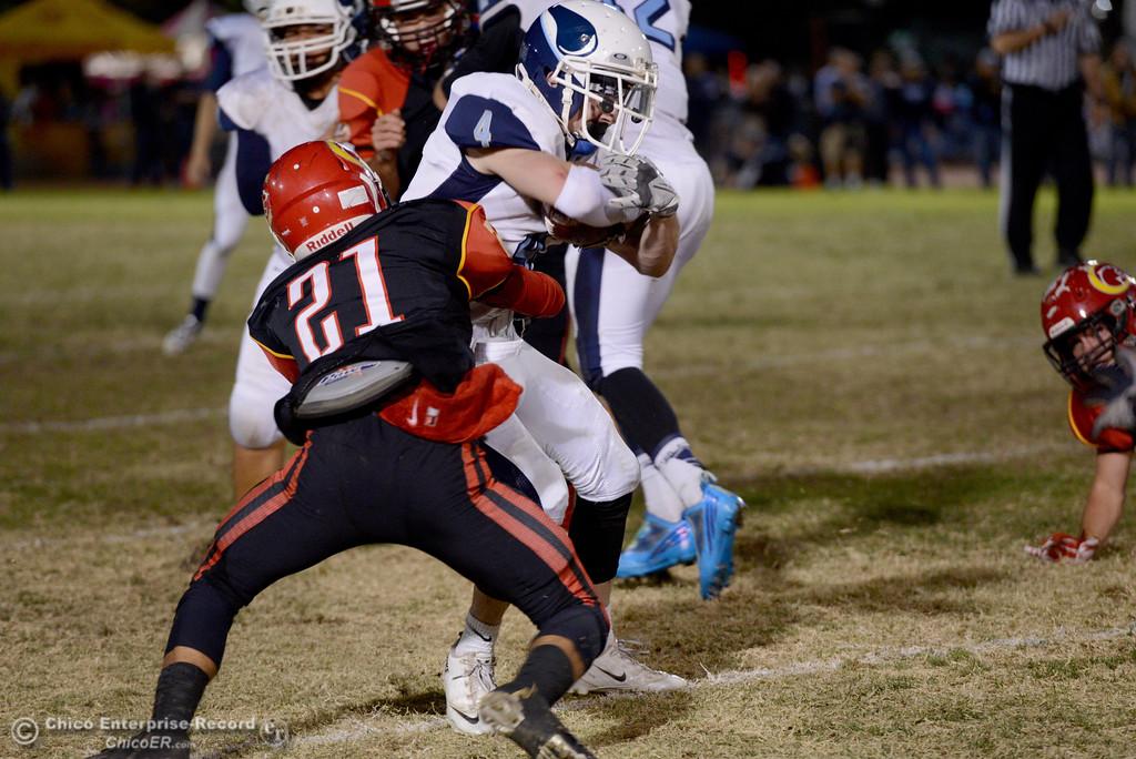 . Cameron Alfaro (21) wraps up Pleasant Valley\'s Cyland Leitner (4) during the Almond Bowl at University Stadium in Chico, California. (Dan Reidel -- Enterprise-Record)