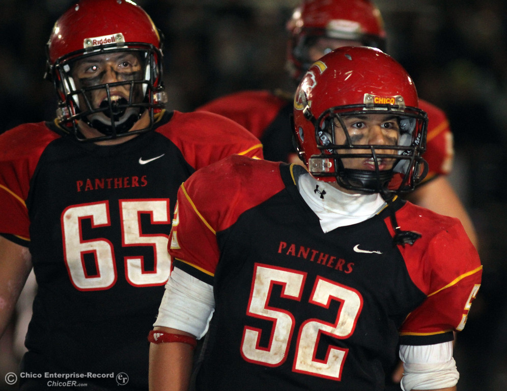 . Chico High\'s #65 Anthony Rodriguez and #52 Caleb Akers (right) against Pleasant Valley High in the fourth quarter of their Almond Bowl football game at CSUC University Stadium Friday, October 26, 2012 in Chico, Calif. (Jason Halley /Chico Enterprise-Record)