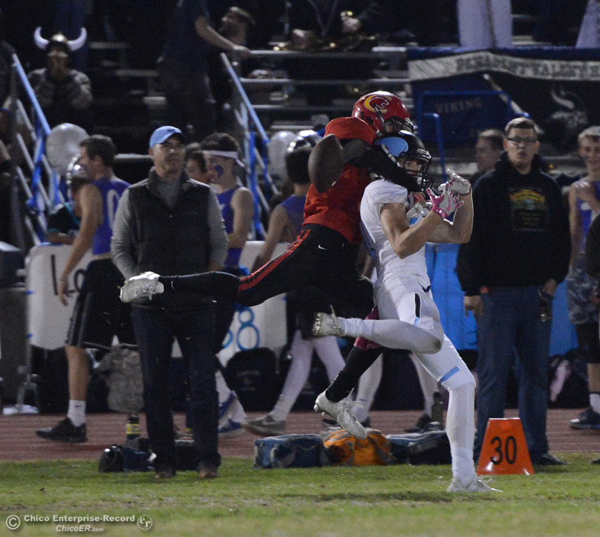 . Chico\'s Blayn Gieg defends a pass intended for Pleasant Valley\'s Trevor Owens during the Almond Bowl on Friday, Oct. 21, 2016, at University Stadium in Chico, California.