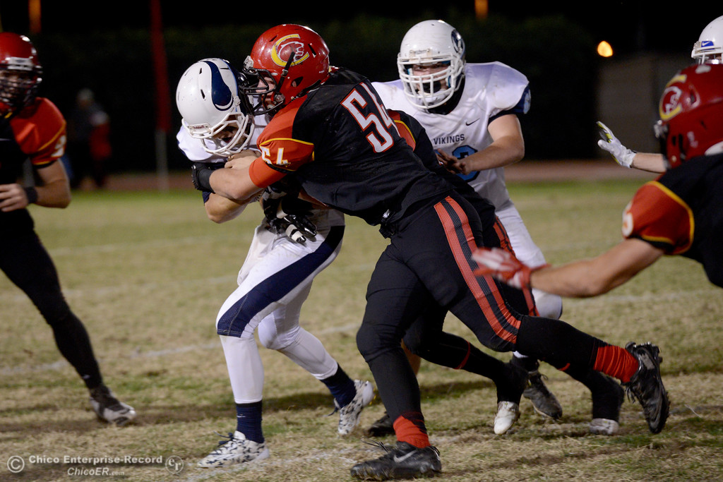 . Chico\'s Bailey Fritter (54) wraps up Pleasant Valley quarterback Trent Darms during the Almond Bowl at University Stadium in Chico, California. (Dan Reidel -- Enterprise-Record)