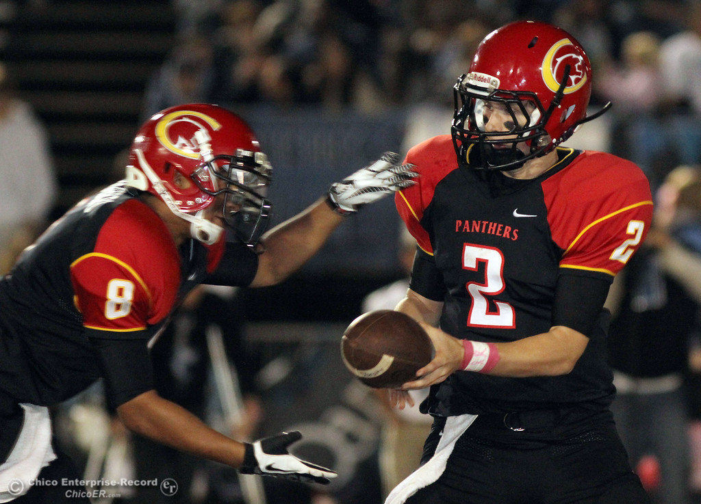 . Chico High\'s #2 Daniel Robbins (right) hands off to #8 Jesse Chambers (left) against Pleasant Valley High in the fourth quarter of their Almond Bowl football game at CSUC University Stadium Friday, October 26, 2012 in Chico, Calif. (Jason Halley /Chico Enterprise-Record)