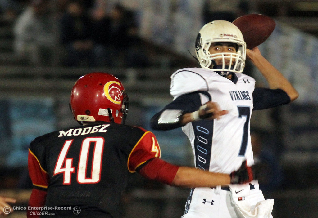 . Chico High\'s #40 Andrew Morgan-Hernandez (left) defends against Pleasant Valley High\'s #7 Zane Ferguson (right) in the fourth quarter of their Almond Bowl football game at CSUC University Stadium Friday, October 26, 2012 in Chico, Calif. (Jason Halley /Chico Enterprise-Record)