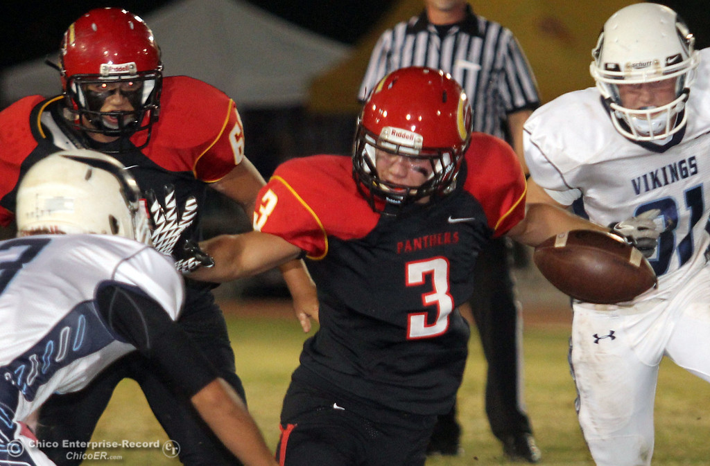 . Chico High\'s #3 Cordero Rios (right) rushes against Pleasant Valley High\'s #3 Brandon Romero (left) in the first quarter of their Almond Bowl football game at CSUC University Stadium Friday, October 26, 2012 in Chico, Calif. (Jason Halley /Chico Enterprise-Record)