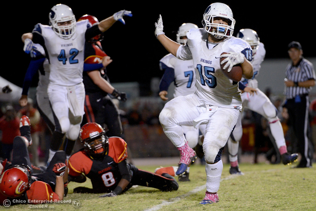 . Anthony Jensen (15) runs in a touchdown that gives Pleasant Valley a lead with 1 minute and 40 seconds left in the Almond Bowl at University Stadium in Chico, California. Chico would later tie, send the game into overtime and beat the Vikings.(Dan Reidel -- Enterprise-Record)