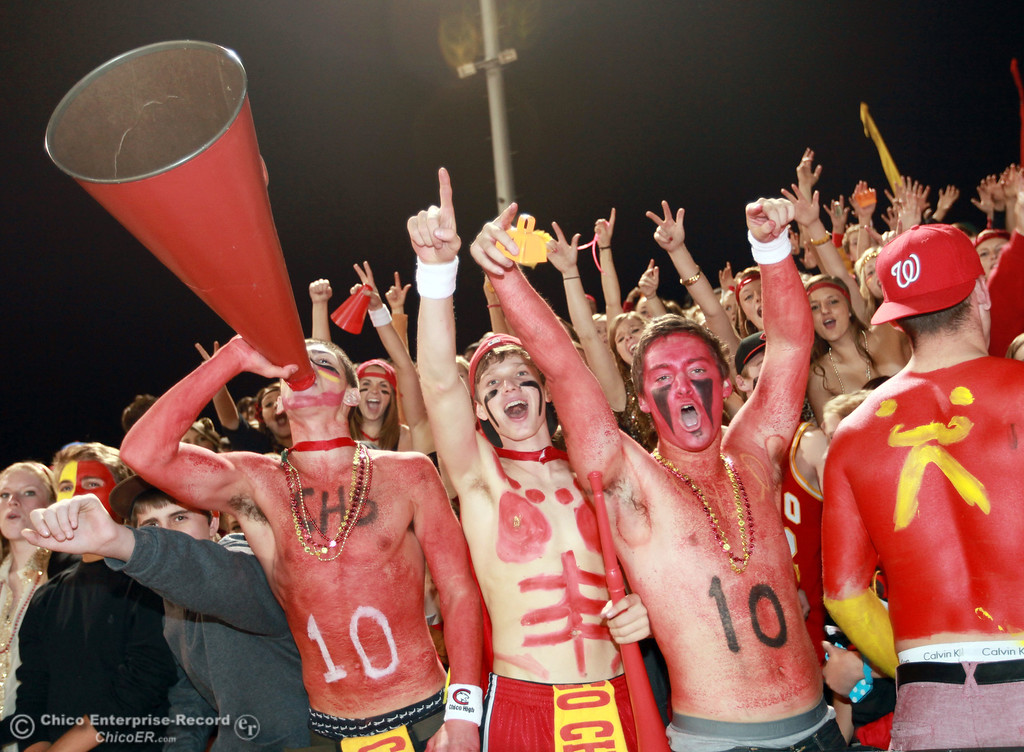 . Chico High fans Tony Bondurant, Tanner Binsfield, and Ben Nokleby, (front row, left to right) cheer on the team against Pleasant Valley High in the second quarter of their Almond Bowl football game at CSUC University Stadium Friday, October 26, 2012 in Chico, Calif. (Jason Halley /Chico Enterprise-Record)