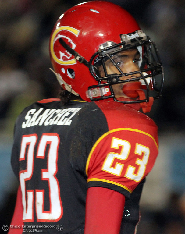 . Chico High\'s #23 Donovan Sanchez against Pleasant Valley High in the fourth quarter of their Almond Bowl football game at CSUC University Stadium Friday, October 26, 2012 in Chico, Calif. (Jason Halley /Chico Enterprise-Record)