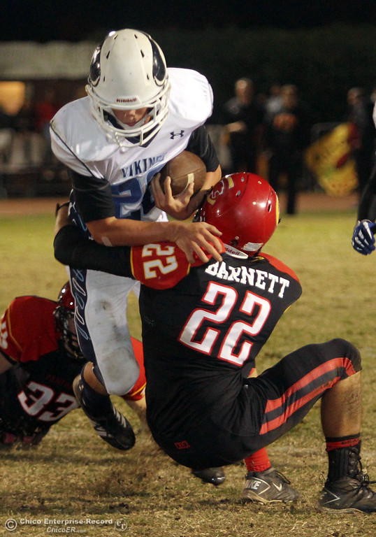 . Chico High\'s #22 Ryan Barnett (right) tackles against Pleasant Valley High\'s #20 Matt Price (left) in the second quarter of their Almond Bowl football game at CSUC University Stadium Friday, October 26, 2012 in Chico, Calif. (Jason Halley /Chico Enterprise-Record)