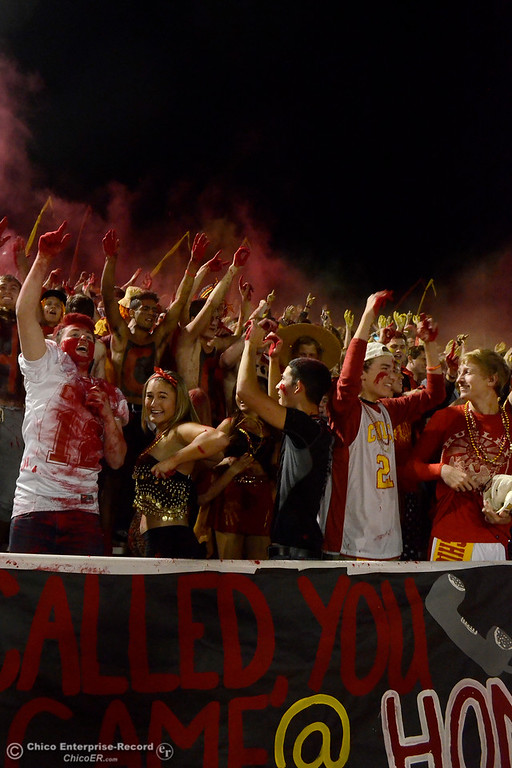 . Chico students throw colored powder in to the air they cheer for the Panthers during the Almond Bowl at University Stadium in Chico, California. (Dan Reidel -- Enterprise-Record)