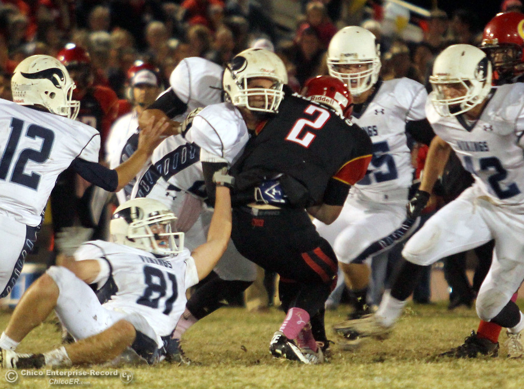 . Chico High\'s #2 Daniel Robbins is sacked against Pleasant Valley High in the first quarter of their Almond Bowl football game at CSUC University Stadium Friday, October 26, 2012 in Chico, Calif. (Jason Halley /Chico Enterprise-Record)
