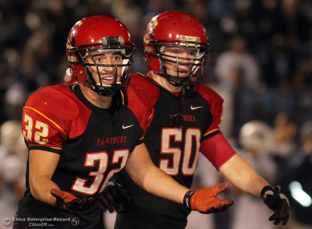 . Chico High\'s #32 KJ Young (left) and #50 Sam Miller (right) against Pleasant Valley High in the fourth quarter of their Almond Bowl football game at CSUC University Stadium Friday, October 26, 2012 in Chico, Calif. (Jason Halley /Chico Enterprise-Record)