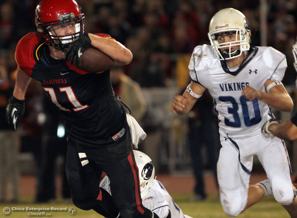 . Chico High\'s #11 Jesse Holmes (left) rushes against Pleasant Valley High\'s #30 Connor Melton (right) in the third quarter of their Almond Bowl football game at CSUC University Stadium Friday, October 26, 2012 in Chico, Calif. (Jason Halley /Chico Enterprise-Record)