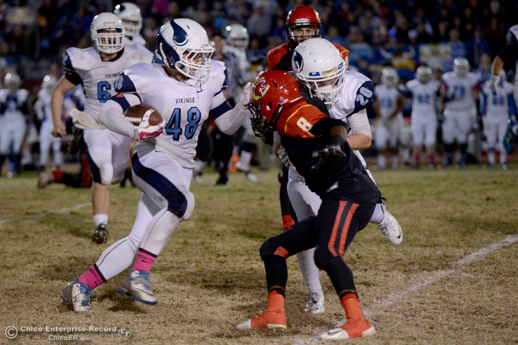 . Pleasant Valley\'s Devin Berger (48) gets a downfield block by teammate JT Morris (20) on Chico\'s Kehmarr Mcmillian (8) during the Almond Bowl at University Stadium in Chico, California. (Dan Reidel -- Enterprise-Record)