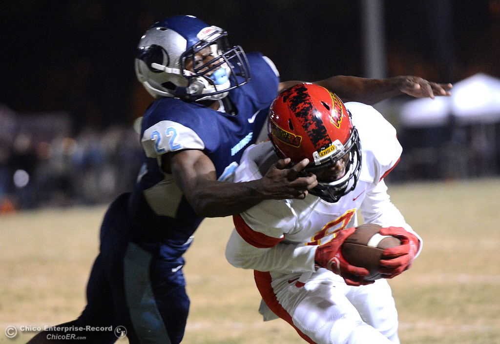. Chico\'s Kehmarr McMillian (8) manages to cathc the ball and run it into the end zone despite the facemask by Carl Robinson (22) on Friday, Oct. 23, 2015, during the 45th Almond Bowl between Chico and Pleasant Valley high schools at University Stadium in Chico, California. (Dan Reidel -- Enterprise-Record)